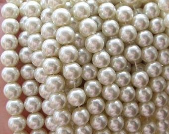 set of 30 ivory pearls 10 mm