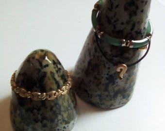 2 door ring cones, jewelry stand, bracelets, rings, necklaces, clay cones, gray rocks