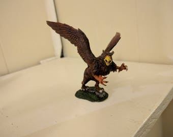 Painted wild Griffin miniature.