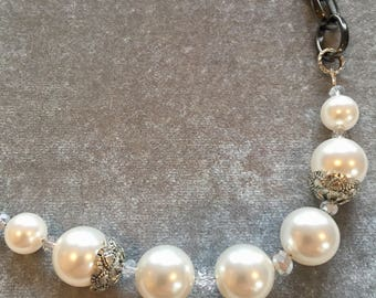 Swarovski pearls, silver beads, crystals and dark-silver finished chain
