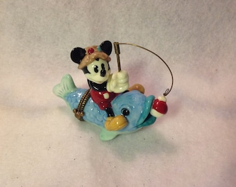 Mickey mouse Christmas catching a fish bigger than him, PHB Midwest of Cannon Falls