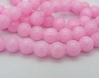 48 has 50 8 mm pink jade beads with a 1 mm hole