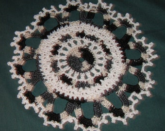 """Black and white doily, 9"""" across"""