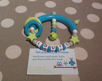 Customizable rattle with lime green turquoise star name