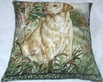 A lovely Golden Labrador eagerly ready and waiting for action cushion