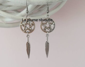 Pentacles and silver feather earrings. Pagan. Witchy. Witchcraft.