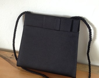 Evening bag in black peaudusoir by Brooks Brothers