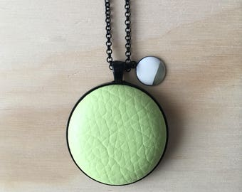 38mm Light Green Faux Leather Button Pendant Necklace with White & Gold Charm • 76cm Black Rolo Chain with Lobster Clasp • Nickel Free