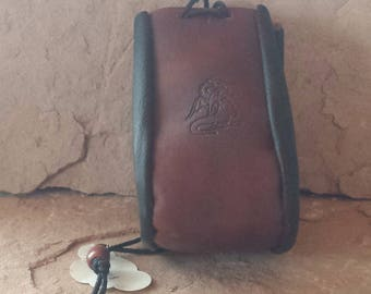 Handmade leather drawstring pouch with Dragon and Celtic knot design suitable for keeping your trinkets, dice, coins or whatever safe.
