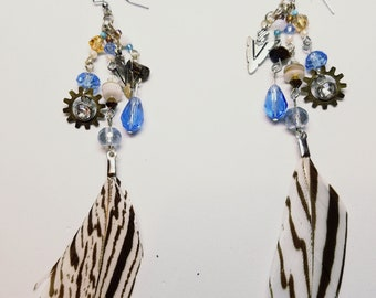 brown and white striped feather with blue and brown beads