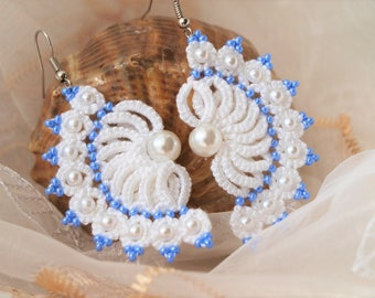 White tatting earrings with blue beads