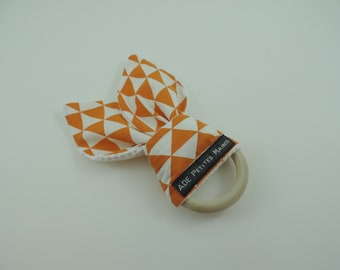Orange and white graphic pattern wooden Bunny teether