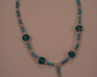 Light blue and white fashion necklace with its tip
