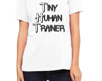 Tiny Human Trainer V-Neck Relaxed Fit T-Shirt (BC 6405). Mother. Parenting. Teaching.