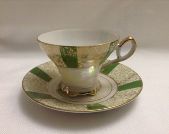 Beautiful Vintage footed teacup and saucer