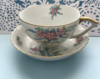 Occupied Japan Hand Painted Tea Cup and Saucer Gayety pattern. Translucent bone china.