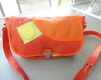 Your orange leather shoulder bag