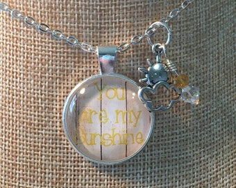 You are my sunshine pendant necklace.