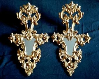 Couple of Cornucopias mirrors XIX century. Carved Wood gold leaf