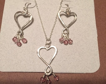 Silver hand formed and hammered heart neclace and earrings adorned with pink quartz beads.