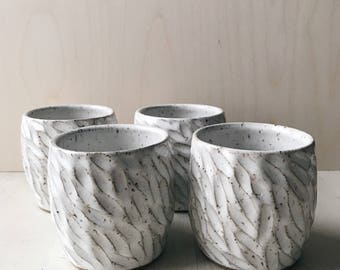 Carved Speckled White Ceramic Cup