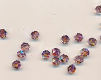 Twelve dazzling limited edition Swarovski crystals: art 5000 - 8 mm - light amethyst AB 2X