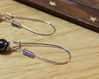 Star traveler hematite earrings