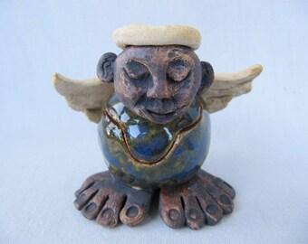 Whimsical hand built clay pottery angel jar