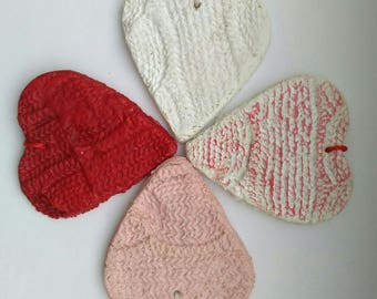 Set of four salty dough knitted hearts