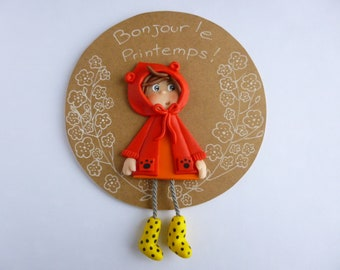 """Round frame """"Hello"""" spring with girl polymer clay"""