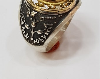 Gold and Silver Ring set with Red Garnet, 18 Karat gold and Sterling Silver.