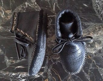 Buffalo hide moccasins lined with elkskin, with a double buffalo insole , with an additional rubber bottom
