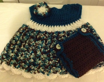 Dress sized 9 to 12 months in teal multi print yarn diaper cover with flower detail