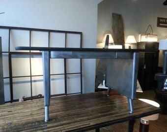 Vintage industrial stripped steel midcenturey desk.