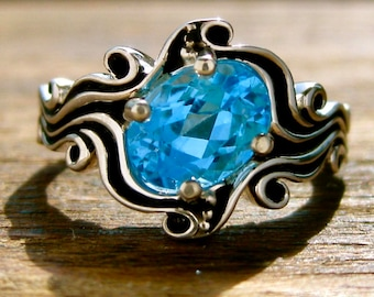 Oval Blue Topaz Engagement Ring in Sterling Silver with Ocean Sea Surf Theme and Blackened Waves or Grooves Size 7