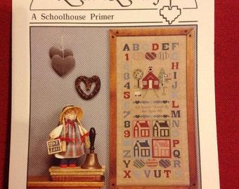 A Schoolhouse Primer.   Heartstrings cross stitch pattern.