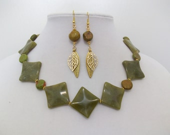 Jade green and gold diamond shape necklace with gold feather earrings.