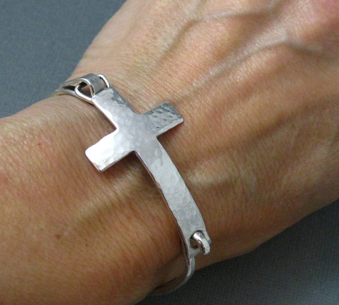 bangles round loop cross charm mfg detailed with a double bangle bracelet bliss by
