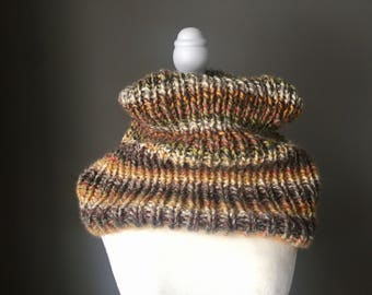 Cozy, soft and squishy hand knit cowl made with a wool blend yarn.