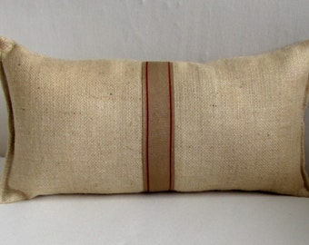blonde burlap lumbar pillow with decorative tape in spice