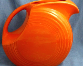 Vintage Fiesta Red Disk Water Pitcher with Ice Lip Old Orange Red Color
