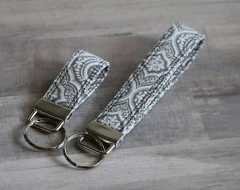 Gray and White Key Fob