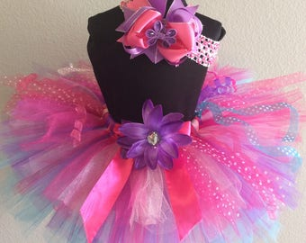 Pink, turquoise, and purple tutu and matching hair bow- sewn up to girls' 6x