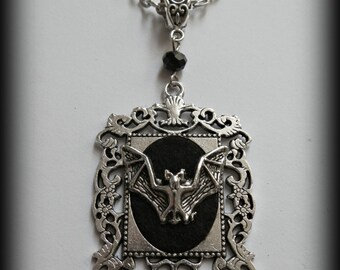 Gothic mounted bat cameo necklace.