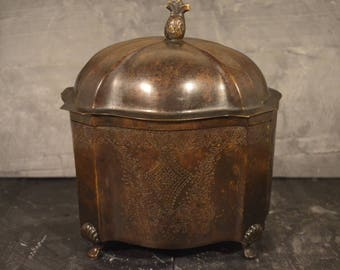Unusual engraved metal tea caddy with pineapple lid