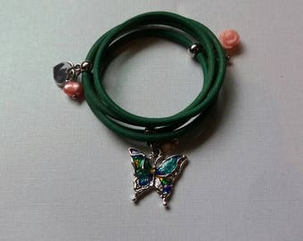Childerens leather wrap bracelet with charms.