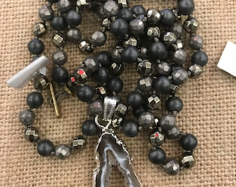 pyrite, hematite, and black onyx knotted necklace with a silver encrusted geode