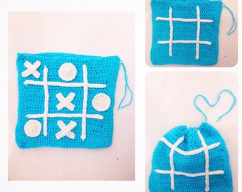 Game of tic tac toe with crocheted storage bag