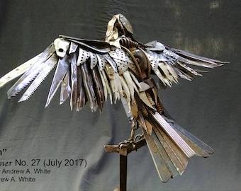 Call It In: scrap metal Mississippi Kite sculpture