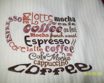 Cream color kitchen towel with coffee cup word desgin